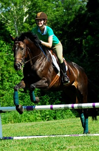 A student in a jumping class at Meredith Manor.